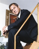 Tony Curtis Seated on the Stairs wearing Black Coat and Tie Photo by  Movie Star News