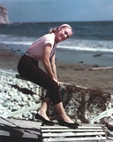 Shirley Jones Posed in White Sleeveless Shirt and Dark Brown Long Pants with Hands on the Knees Photo by  Movie Star News