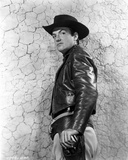 William Campbell standing in Leather Jacket With Black Hat Photo by  Movie Star News