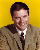Larry Hagman smiling in Yellow Background Photo by  Movie Star News