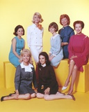 Peyton Place Ladies Cast Portrait in Formal Dress with Yellow Background Foto av  Movie Star News