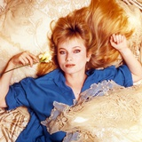 Rebecca Demornay Lying in Blue Polo Photo by  Movie Star News