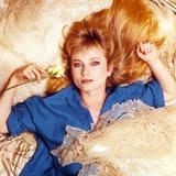 Rebecca Demornay Lying in Blue Polo Photo by  Movie Star News