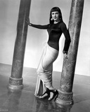 Maria Montez standing in Black and White Dress with Heels Photo by  Movie Star News
