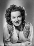 Maureen O'Hara smiling in Glittered Vest Photo by E Bachrach