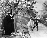 Wizard Of Oz Witch Waiting for Couple in Black and White Photo by  Movie Star News