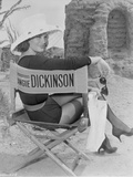 Angie Dickinson sitting on Chair with Hat Black and White Photo by  Movie Star News