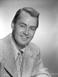 Alan Ladd smiling and wearing a Stripe Suit in Portrait in Classic Photo by  Movie Star News