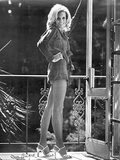 Angie Dickinson standing Near the Railings wearing Long Sleeves and Shoes in Black and White Photo by  Movie Star News