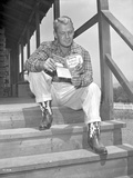 Alan Ladd sitting on the Stairs Reading Close Up Portrait Photo by  Movie Star News