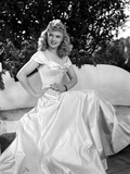 Anna Neagle on a Gown and sitting Photo by  Movie Star News