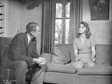 Anatomy Of A Murder Woman Talking to a Guy While sitting on the Sofa in a Movie Scene in Black and  Photo by  Movie Star News