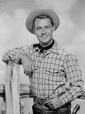 Alan Ladd smiling Near the Fence in Cowboy Outfit Photo by  Movie Star News