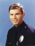 Adam-12 Posed in Police Officer Uniform with a Smile in a Portrait wish Blue Background Photo by  Movie Star News