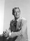 Alan Ladd sitting , Facing Left in Suit Close Up Portrait Photo by  Movie Star News