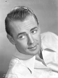 Alan Ladd Lying Pose, wearing White Polo Close Up Portrait Photo by  Movie Star News