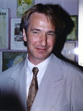 Alan Rickman smiling and wearing a Grey Suit Close Up Portrait Photo by  Movie Star News