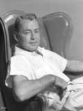Alan Ladd sitting on a Chair in Close Up Portrait Photo by  Movie Star News