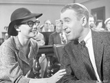 Anatomy Of A Murder Man Talking Happily to a Woman in a Movie Scene in Black and White Photo by  Movie Star News