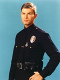 Adam-12 Man in Police Uniform Making Serious Face in Blue Background Photo by  Movie Star News
