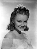 Ann Gillis smiling and wearing an Off-Shoulder Top Portrait Photo by  Movie Star News