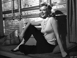 Anne Francis sitting Beside the Window Photo by  Movie Star News