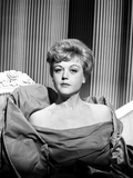Angela Lansbury sitting on the Chair wearing a Dress Photo by  Movie Star News