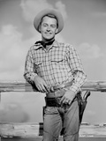 Alan Ladd Leaning on a Wooden Fence in Cow Boy Outfit Photo by  Movie Star News