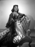 Donna Reed on a Dress Kneeling on Couch in Black and White Photo by  Movie Star News