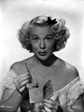 Betty Hutton on an Off Shoulder Dress and Holding a Paper Photo by  Movie Star News