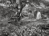 Brigadoon Excerpt Man and Housemaid Putting Candles on Cake with Lady in Dress Photo by  Movie Star News