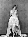 Corrinne Griffith on a Dress standing and Leaning Portrait Photo by  Movie Star News