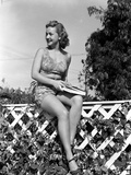 Bonita Granville on a Midriff and sitting on a Fence Photo by  Movie Star News