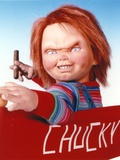 Chucky Holding Tabaco in Stripes Long Sleeve Photo by  Movie Star News