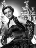Alexis Smith sitting and wearing a Black Dress and Gloves Photo af Movie Star News
