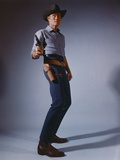 Chuck Connors standing in Cowboy Outfit with Pistol Photo by  Movie Star News