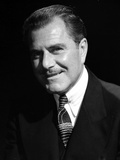 Ben Lyons Portrait smiling in Black Suit and Black Ties Photo by  Movie Star News