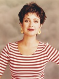 Annie Potts posed in Red and White Striped Top with Yellow Earrings Photo by  Movie Star News