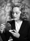 Alexis Smith Looking in a Small Mirror wearing Black Suit Photo af Movie Star News