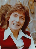 David Cassidy smiling in Red Vest Photo by  Movie Star News