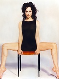Bebe Neuwirth Siting on Char in Black Dress Photo by  Movie Star News