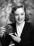 Alexis Smith smiling while Holding a Make up Kit Photo af Movie Star News