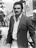 Burt Reynolds wearing a Black Suit Photo by  Movie Star News