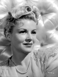 Claire Trevor in White with Pearl Necklace Photo by  Movie Star News