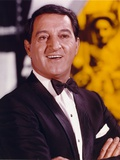 Danny Thomas smiling in Black Tuxedo with Gold Watch Photo by  Movie Star News