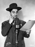 Danny Thomas standing in Black Suit With Hat Photo by  Movie Star News