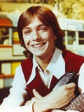 David Cassidy smiling in Red Vest with Guitar Photo by  Movie Star News
