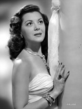 Ann Rutherford Leaning on the Wall wearing a Strapless White Dress Photo by  Movie Star News