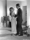 Chase Begging in Black Suit and White Dress Photo by  Movie Star News