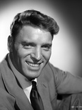 Burt Lancaster wearing Suit in Squat Pose Photo by  Movie Star News